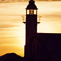 Lighthouse At Sunset by Mary Mikawoz