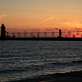 Lighthouse At Sunset by Timothy Johnson