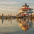 Lighthouse Glow And Reflection  by Janet Barnes