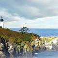 Lighthouse On A Jetty. by Greg Chapel