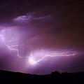 Lightning Reaching Down  by Jeff Swan