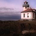 Limekiln Lighthouse With Storm Approaching by Kerry Hartjen