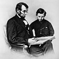 Lincoln Reading To His Son by Photo Researchers