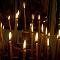 lit Candles in church  by Danny Yanai