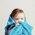 Little Baby Girl Tucked In A Cozy Blue Blanket. by Michal Bednarek
