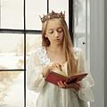 Little Girl Reading Book by Amanda Elwell