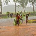 Local People Crossing The Road In Malawi by Marek Poplawski