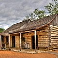 Log Cabin In Lbj State Park by David and Carol Kelly