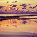 Lone Fisherman In Distance During Beautiful Reflected Sunset With Dramatic Clouds In Maldives by Srdjan Kirtic