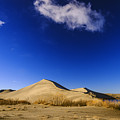 Lonely Cloud Over Sand Dunes At Bruneau Dunes State Park Idaho Usa by Vishwanath Bhat