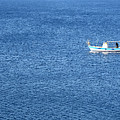 Lonely Fishing Boat Sailing On A Calm Blue Sea by Michalakis Ppalis