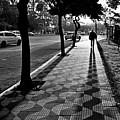 Lonely Man Walking At Dusk In Sao Paulo by Carlos Alkmin
