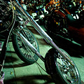 Long Front Fork And Wheel Of Chopper Bike At Night by Jason Rosette