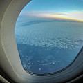 Looking Out Of Airplane Window During Flight by Alex Grichenko