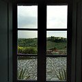 Looking Through The Window Of A Tuscan by Todd Gipstein