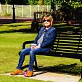 Lorna On A Bench by Nik Watt