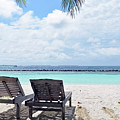 Lounge Chairs At The Beach In Maldives by Oana Unciuleanu