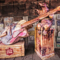 Luckenbach's Guitar-playing Armadillo by Andy Crawford