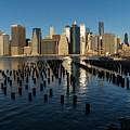 Luminous Blue Silver And Gold - Manhattan Skyline And East River by Georgia Mizuleva