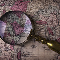 Magnifying  Glass On Old Map by Garry Gay