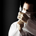 Male Doctor With Needle Syringe On Dark Background by Jorgo Photography - Wall Art Gallery