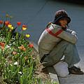 Man Alone Sitting On Curb by Jim Corwin