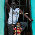 Man And Son In The Window by Dan Hartford
