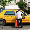 Man Asks For Information A Taxi Driver In Manhattan. by Antonio Gravante