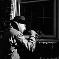Man Breaking Into Building, C.1950s by H. Armstrong Roberts/ClassicStock