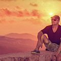 Man Enjoying Sunset by Anna Om