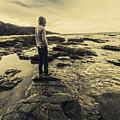 Man Gazing Out On Coastal Rocks by Jorgo Photography - Wall Art Gallery