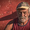Man In Trinidad Cuba by Joan Carroll