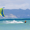 Man Kiteboarding In Turquoise Water by Mark Cosslett