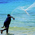 Man Launching His Fishing Net Into The Crystal Water by Sami Sarkis
