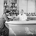 Man Ordering Another Drink, C. 1940s by H. Armstrong Roberts/ClassicStock