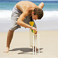 Man Playing Beach Cricket by Jorgo Photography - Wall Art Gallery