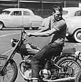 Man Riding A Motorcycle by Underwood Archives