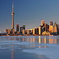 Man Standing On Frozen Lake Ontario Ice Looking At Toronto City  by Reimar Gaertner