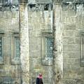 Man Walking Between Columns At The Roman Theatre by Sami Sarkis