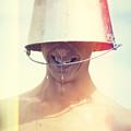 Man Wearing Water Bucket On Head In Summer Heat by Jorgo Photography - Wall Art Gallery