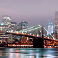 Manhattan And Brooklyn Bridge Under Fog. by Shobeir Ansari