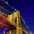 Manhattan Skyline From The Brooklyn Bridge At Dusk by Valentyn Semenov