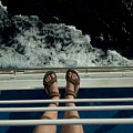Mans Feet In Sandals Standing by Todd Gipstein