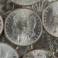 Many American Silver Dollars  by Thomas Baker