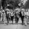 Marchers Wearing Hats Carry Puerto Rican Flags Down Constitution Avenue by Nat Herz