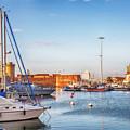 marine harbor in Italian old town Livorno  by Ariadna De Raadt