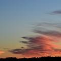 Mauve Clouds In A Blue Sky  by Lyle Crump