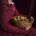 Medieval Woman Holding A Basket Of Apples by Lee Avison