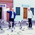 Men And Birds Burano Italy  by John McGraw