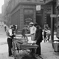 Men Eating Fresh Clams From A Pushcart by Everett